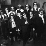 Joe Morton, Dan Aykroyd, John Goodman, J. Evan Bonifant, and The Blues Brothers Band